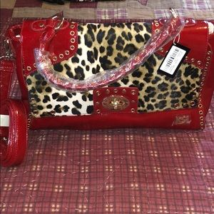 Red animal print Bebe purse, with tag, never used